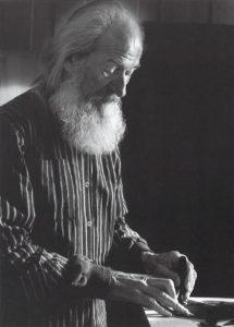 Portrett av Odmun Kristiansen en mann med hvitt skjegg